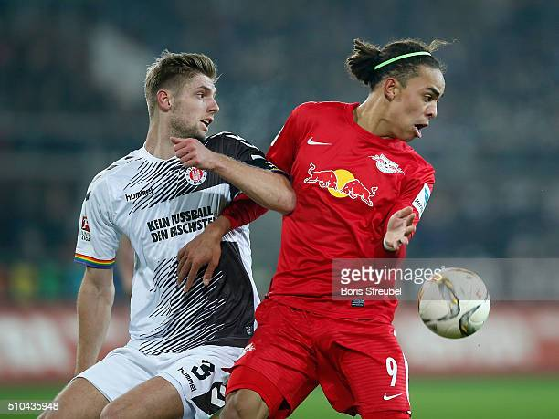 Lasse Sobiech of St Pauli challenges Yussuf Poulsen of Leipzig during the Second Bundesliga match between FC St Pauli and RB Leipzig at Millerntor...