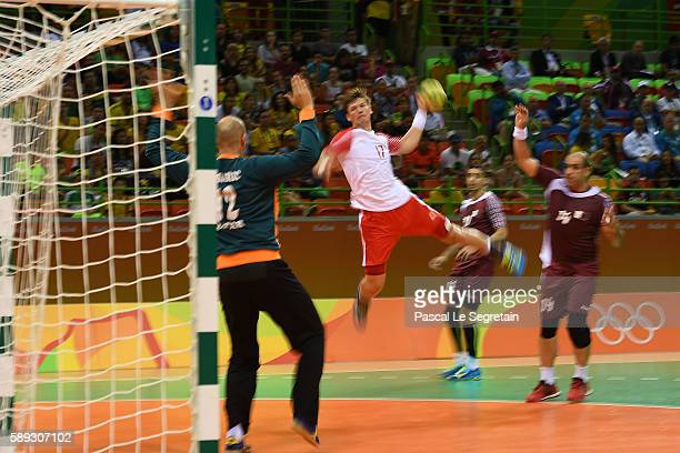 Lasse Svan of Denmark shoots the ball during the men's prelimary group A handball match Denmark vs Quatar at the future arena on day 8 of the Olympic...