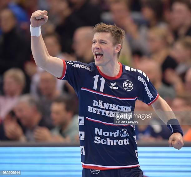 Lasse Svan of Flensburg celebrates during the DKB Bundesliga Handball match between SG FlensburgHandewitt and Fuechse Berlin at FlensArena on March...