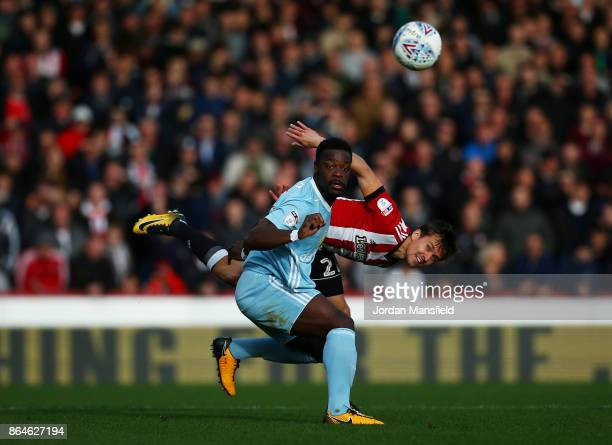Lasse Vibe of Brentford and Lamine Kone of Sunderland challenge for the ball during the Sky Bet Championship match between Brentford and Sunderland...