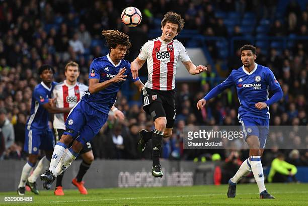 Lasse Vibe of Brentford and Nathan Ake of Chelsea compete for the ball during the Emirates FA Cup Fourth Round match between Chelsea and Brentford at...