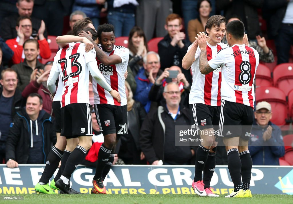 Lasse Vibe of Brentford celebrates with team mates after he scores his sides first goal during the Sky Bet Championship match between Brentford and Derby County at Griffin Park on April 14, 2017 in Brentford, England.