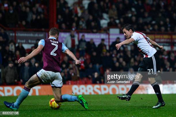 Lasse Vibe of Brentford FC scores the third Brentford goal during the Sky Bet Championship match between Brentford and Aston Villa at Griffin Park on...