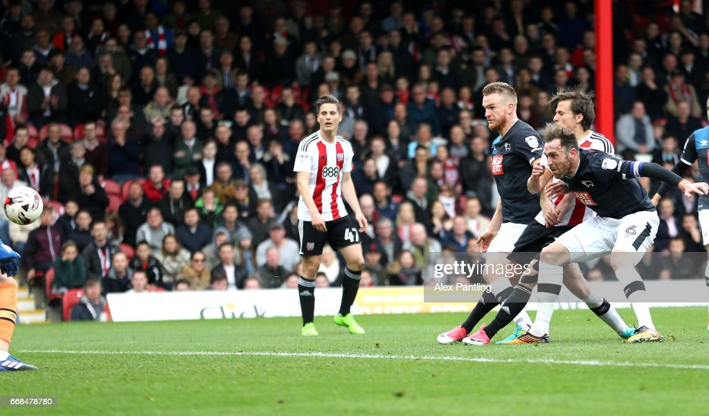 Lasse Vibe of Brentford scores his sides first goal during the Sky Bet Championship match between Brentford and Derby County at Griffin Park on April 14, 2017 in Brentford, England.