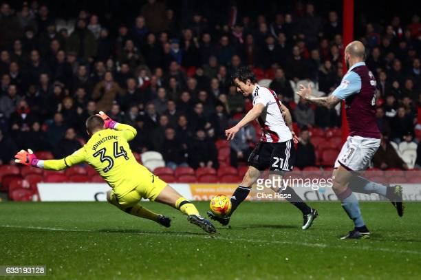 Lasse Vibe of Brentford scores his team's first goal during the Sky Bet Championship match between Brentford and Aston Villa at Griffin Park on...