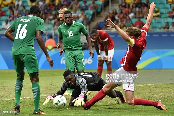 Lasse Vibe of Denmark vies for the ball with goalkeeper Daniel Akpeyi of Nigeria during the Rio 2016 Olympic Games mens quarterfinal football match...