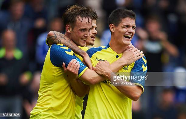 Lasse Vigen Christensen and Christian Norgaard of Brondby IF celebrate after scoring their fifth goal during the Danish Alka Superliga match between...