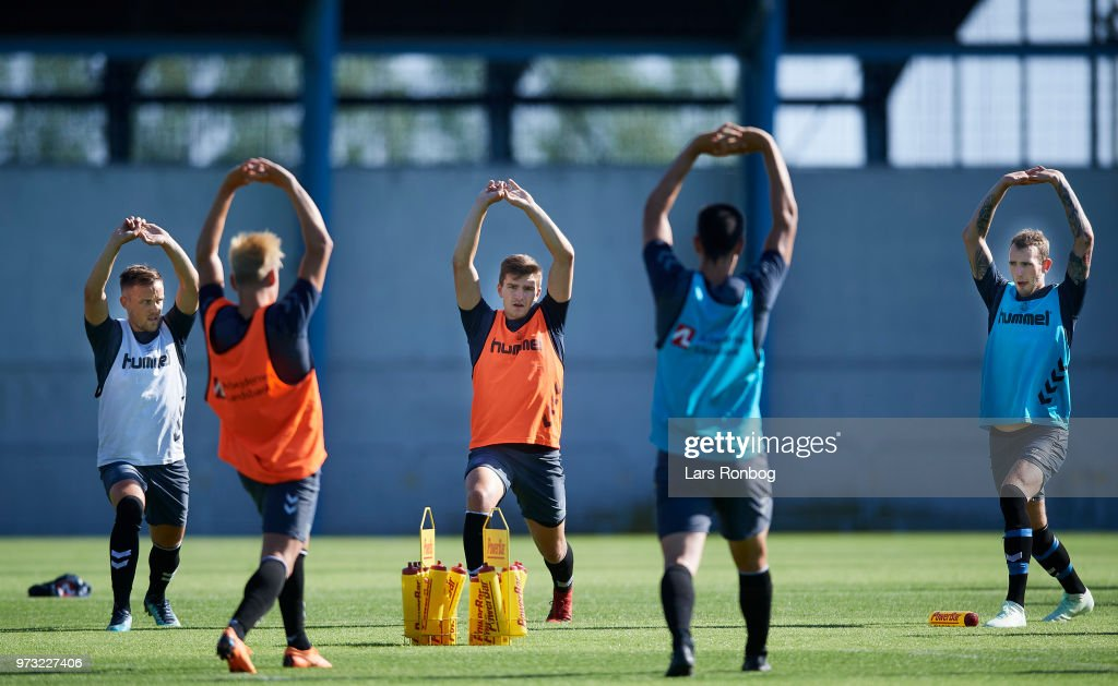 Lasse Vigen Christensen, Mikael Uhre and Jens Martin Gammelby of Brondby IF stretching during the Brondby IF training session at Brondby Stadion on June 13, 2018 in Brondby, Denmark.