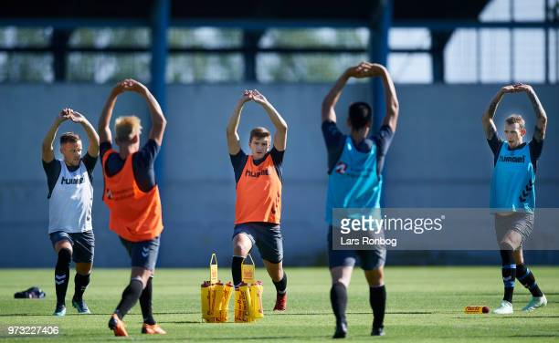 Lasse Vigen Christensen Mikael Uhre and Jens Martin Gammelby of Brondby IF stretching during the Brondby IF training session at Brondby Stadion on...