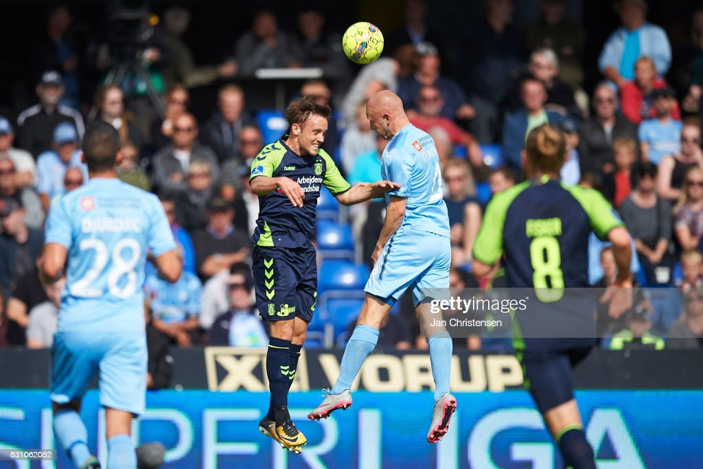 Lasse Vigen Christensen of Brondby IF and Johnny Thomsen of Randers FC heading the ball during the Danish Alka Superliga match between Randers FC and Brondby IF at BioNutria Park Randers on August 13, 2017 in Randers, Denmark.