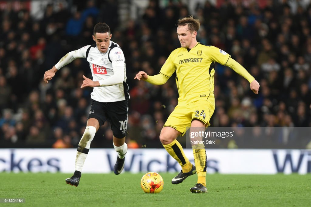 Lasse Vigen Christensen of Burton Albion and Tom Ince of Derby County in action during the Sky Bet Championship match between Derby County and Burton Albion at the iPro Stadium on February 21, 2017 in Derby, England (Photo by Nathan Stirk/Getty Images).