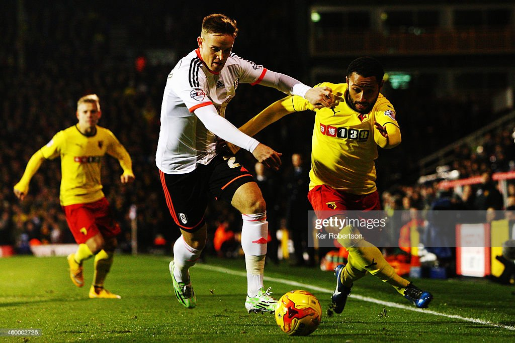 Lasse Vigen Christensen of Fulham and Ikechi Anya of Watford challenge for the ball during the Sky Bet Championship match between Fulham and Watford at Craven Cottage on December 5, 2014 in London, England.