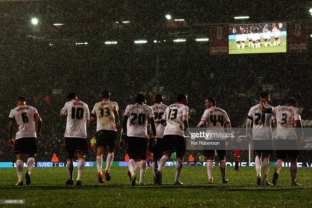 Lasse Vigen Christensen (2nd right) of Fulham is congratulated by team mates after scoring his teams second goal during the Sky Bet Championship match between Fulham and Huddersfield Town at Craven Cottage on November 8, 2014 in London, England.