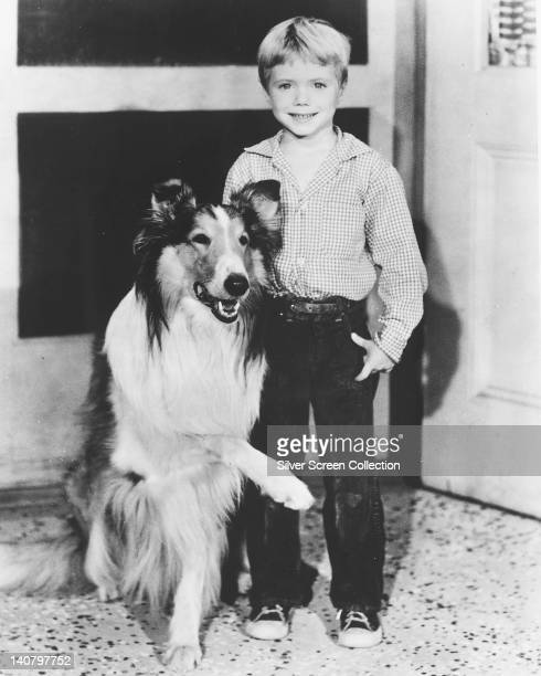 Lassie, a Rough Collie, with Jon Provost, US child actor, wearing a check shirt in an image issued as publicity for the US television series,...