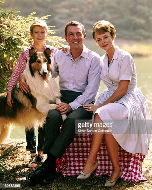 Lassie with Jon Provost US child actor June Lockhart US actress and Hugh Reilly US actor pose for a group portrait issued as publicity for the US...