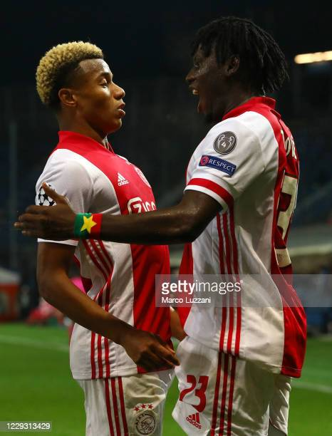 Lassina Traore of Ajax Amsterdam celebrates his goal with his team-mate David Neres during the UEFA Champions League Group D stage match between...