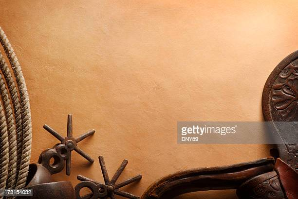 lasso, spurs, and leather saddle flap on brown leather surface - wild west stock pictures, royalty-free photos & images