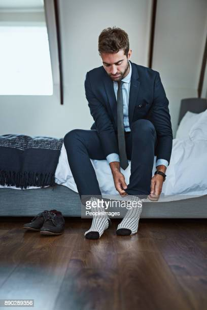 last adjustments - men in white socks stock photos and pictures