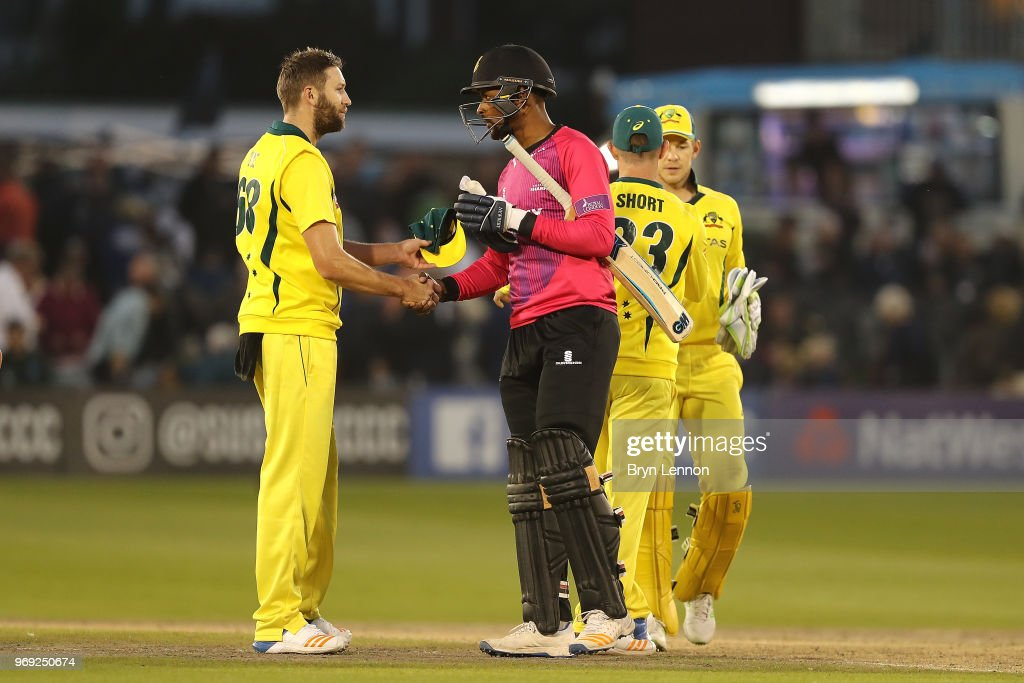 Last batsman Abi Sakande of Sussex shakes hands with Andrew Tye of Australia during the one day tour match between Sussex and Australia at The 1st Central County Ground on June 7, 2018 in Hove, England.
