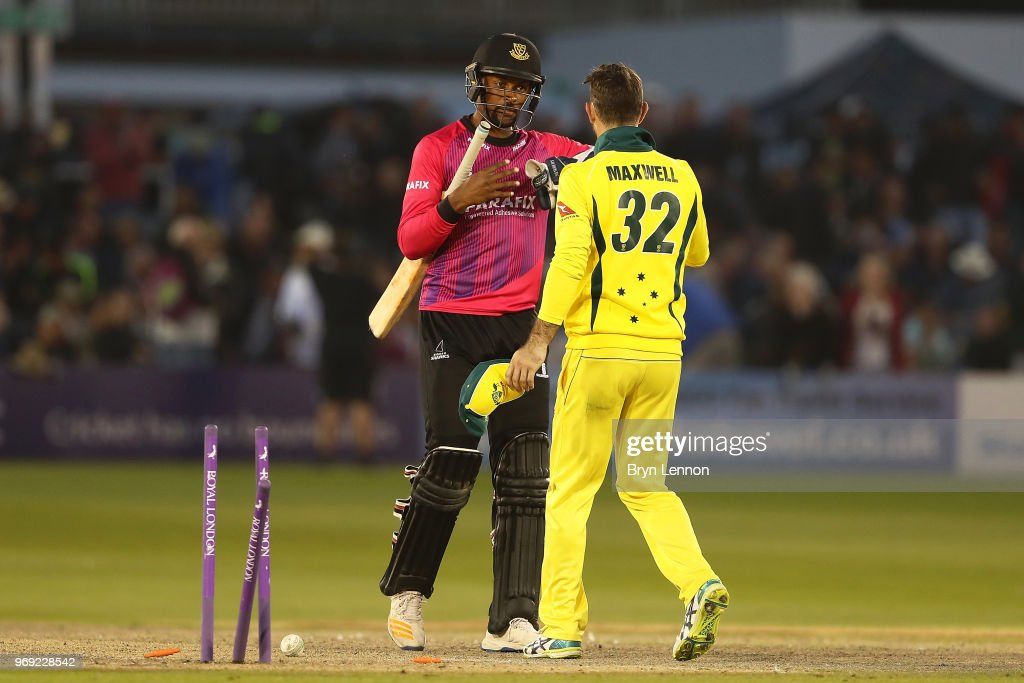 Last batsman Abi Sakande of Sussex shakes hands with Glenn Maxwell of Australia during the one day tour match between Sussex and Australia at The 1st Central County Ground on June 7, 2018 in Hove, England.