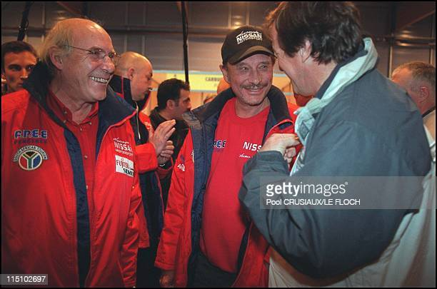 Last check out before the Dakar car rally starts on Friday night in Arras France on December 27 2001 Johnny Hallyday Hubert Auriol and Rene Medge
