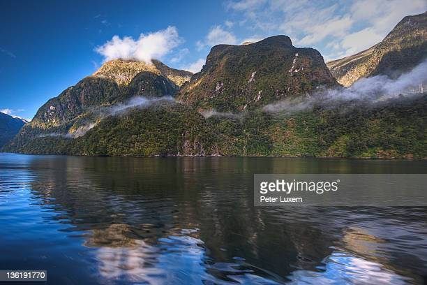 Last clouds are clearing in Doubtful Sound