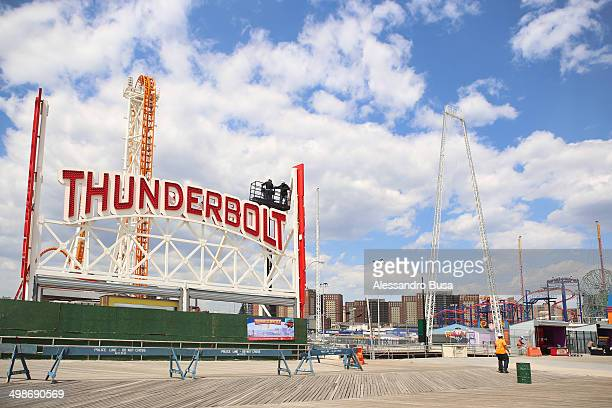"Last finishing works at the new ""Thunderbolt"" rollercoaster in the amusement area of Coney Island, New York City before the opening of the season on..."