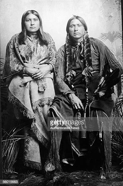Last great chief of the North American Comanche indian tribe Quanah Parker sits and poses for a photograph with one of his eight wives after his...