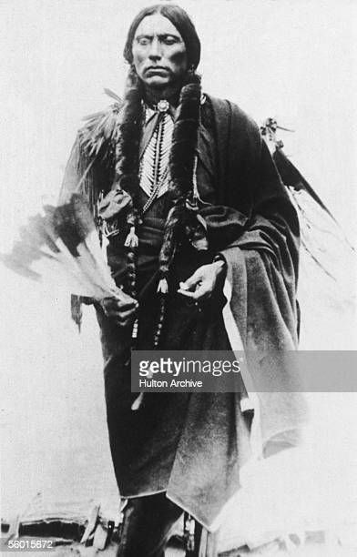 Last great chief of the North American Comanche indian tribe Quanah Parker stands and poses for a photograph late 19th Century Parker the son of...