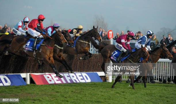 Last Instalment ridden by Brian O'Connell and Teaforthree ridden by Nick Scholfield jump the last in The Betfred Cheltenham Gold Cup Steeple Chase...