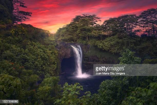 last lights at rainbow falls - hilo (hawaii, usa) - hawaiian waterfalls stock pictures, royalty-free photos & images