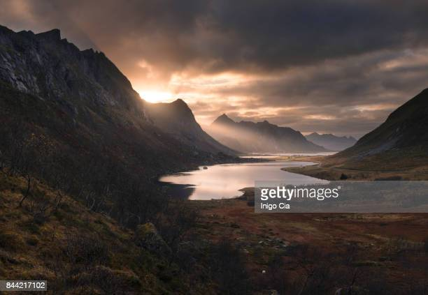last lights over lofoten - sunset lake stock photos and pictures