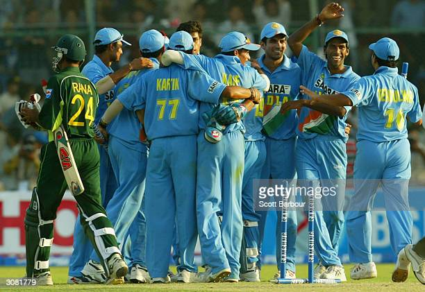 Last man out Moin Khan of Pakistan leaves the field as India celebrate their victory in the first Pakistan v India one day international match played...