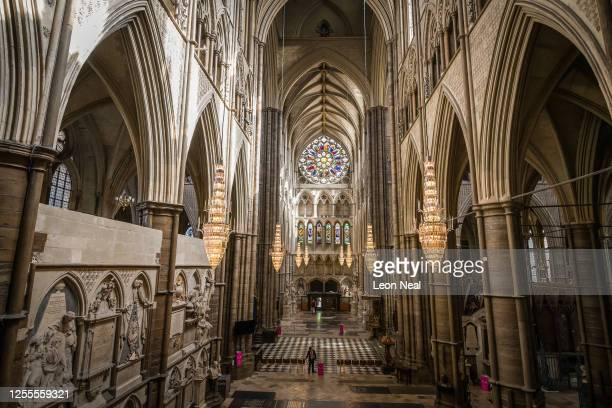 Last minute adjustments are made before the first visitors pass through the doors at Westminster Abbey as it re-opens to the public, on July 11, 2020...