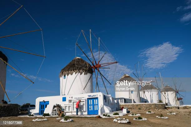 Last minute preparations are made at the Mytho souvenir shop by the Mykonos windmills before the beginning of the delayed tourist season in the...