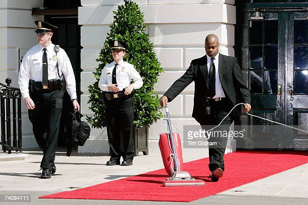 Last minute preparations for Queen Elizabeth II's arrival are made on the White House red carpet on the fifth day of her US tour May 7 2007 in...