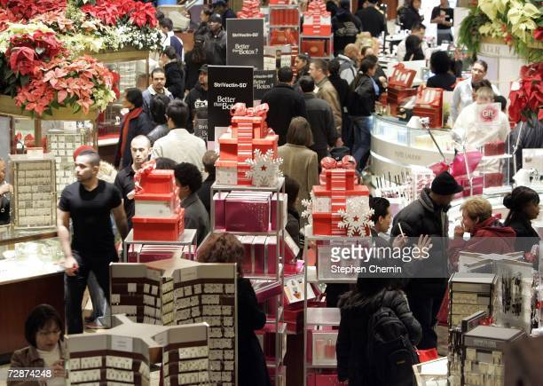 Last minute shoppers peruse merchandise at Macy's December 24 2006 in New York City According to the National Retail Federation retail sales could...