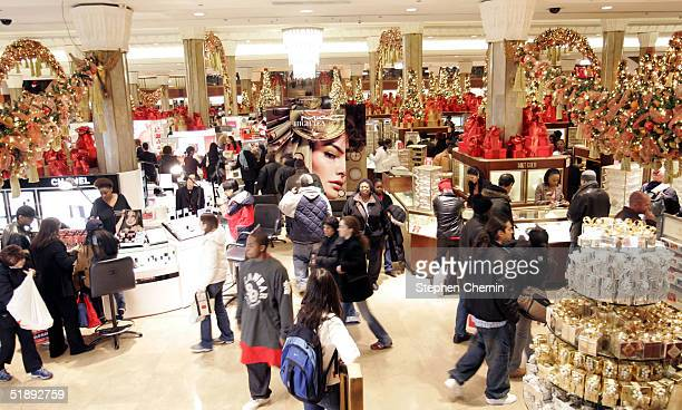 Last minute shoppers peruse the cosmetics area December 24 2004 at Macy's in New York City Retailers suffering with disappointing seasonal sales hope...