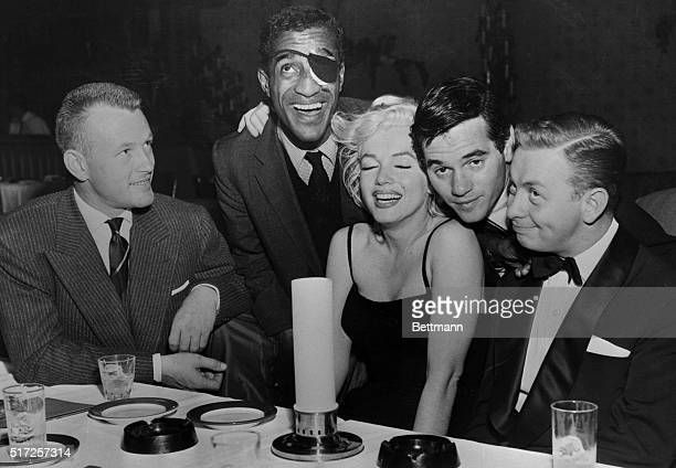 """Last night a group of Hollywood stars paid a visit to Mel Torme, who is singing at the """"Crescendo,"""" a night club on the Sunset Strip. Shown in the..."""