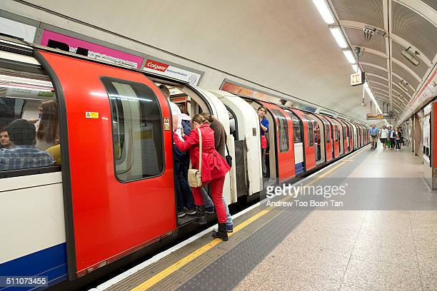 Last passenger to squeeze onto the London Underground train at Tottenham Court Road station