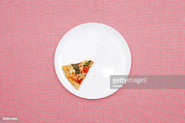 Last slice of pizza on plate