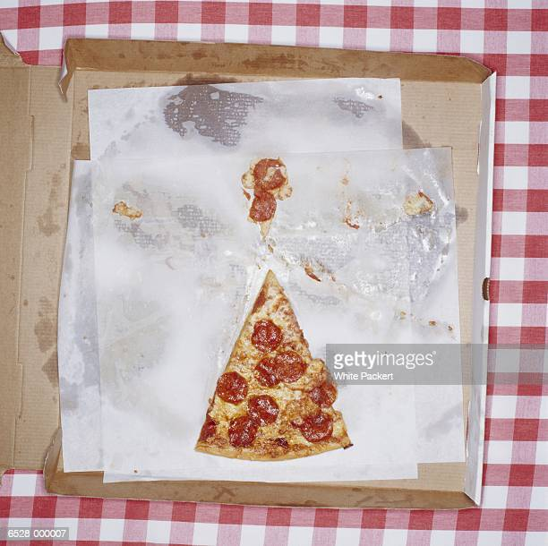 last slice of pizza - pizza slice stock photos and pictures