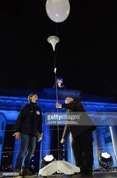 Last Soviet leader Mikhail Gorbachev waits releases a balloon during a Street Party organized by German governement to mark the 25th anniversary of...