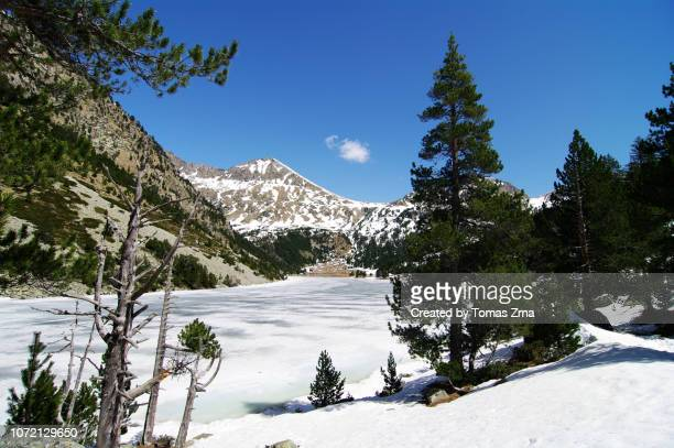 last spring snow at the remote estany llong lake - last stock pictures, royalty-free photos & images