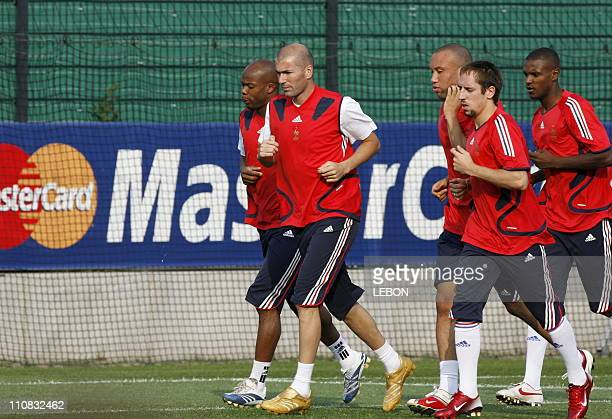 Last Training For French Team Before 2006 Fifa World Cup Final In Berlin Germany On July 082006 Sylvain Wiltord Zinedine Zidane Michael Sylvestre...