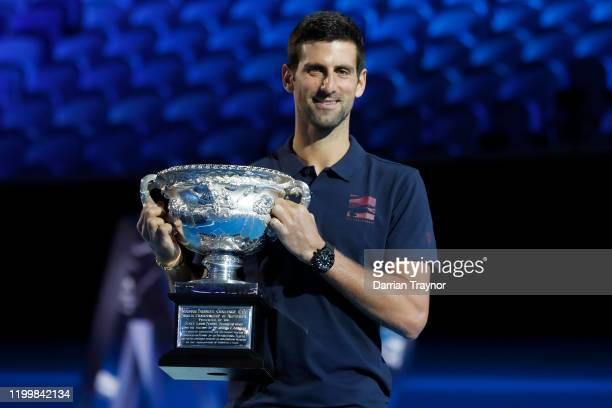 Last years Australian Open Winner Novak Djokovic of Serbia poses with the trophy during the official draw ahead of the 2020 Australian Open at...