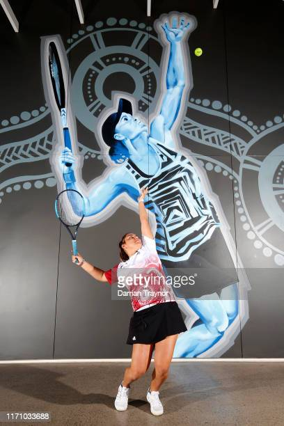 Last years Evonne Goolagong Cawley medal winner Mikayla Zahirovic poses for a photo in front of a new Ash Barty mural during the National Indigenous...