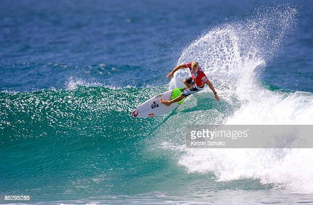 Last year's Quiksilver Pro runner-up Mick Fanning of Australia surfs to a round 3 victory over ASP World Tour rookie Kekoa Bacalso of Hawaii during...