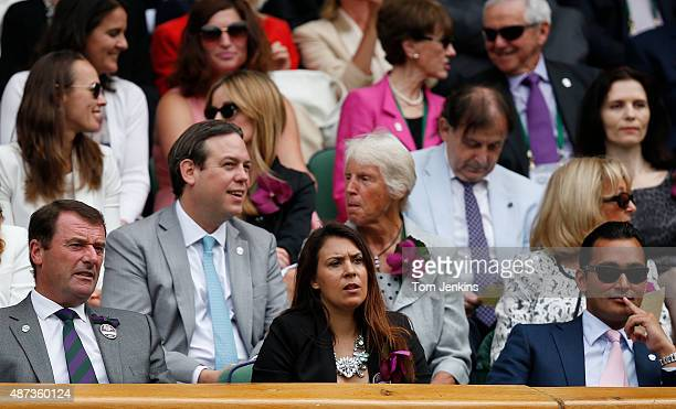 Last years winner Marion Bartoli sits in the front row of the Royal Box watching the womens singles final on Centre Court today during Wimbledon 2014...