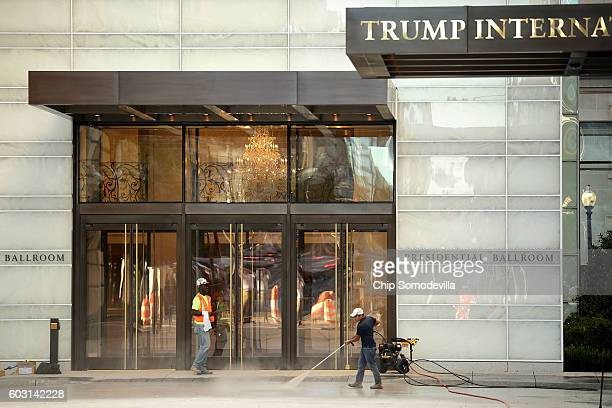 Lastminute preparations are made in front of the Trump International Hotel on the first morning it is open for business September 12 2016 in...